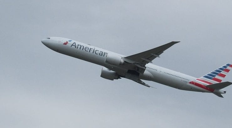 American Airlines' stock climbs after unit revenue outlook raised