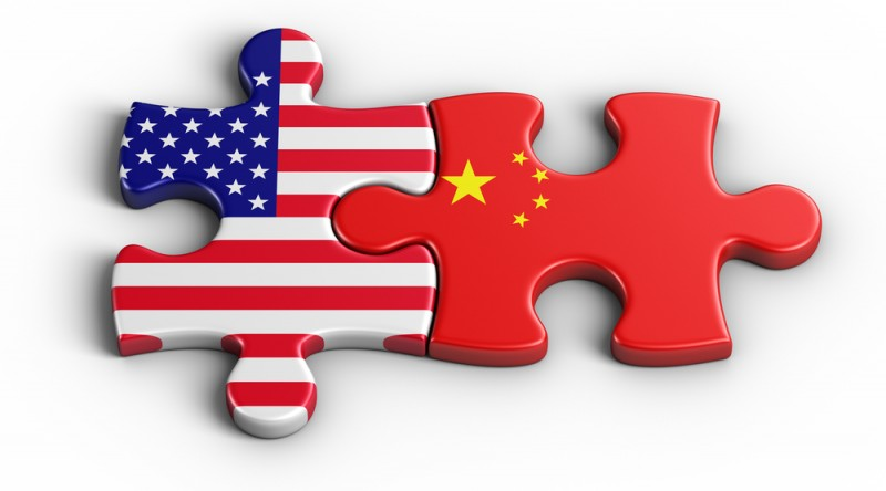 [interlocking Chinese and American flag puzzle pieces]